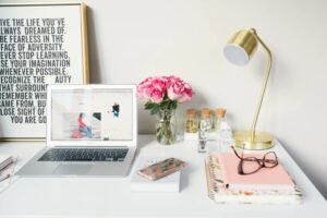 Web design Content on laptop with a golden lamp and a pair of glasses